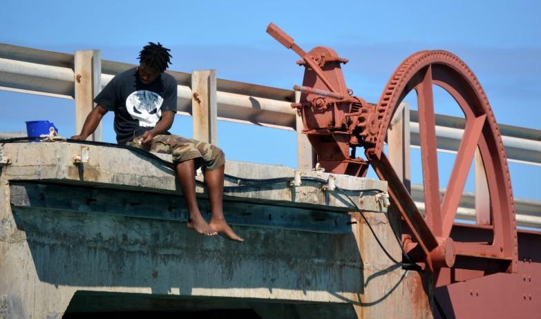 Local fishing off the bridge stretching between Great Exuma Island and Little Exuma Island